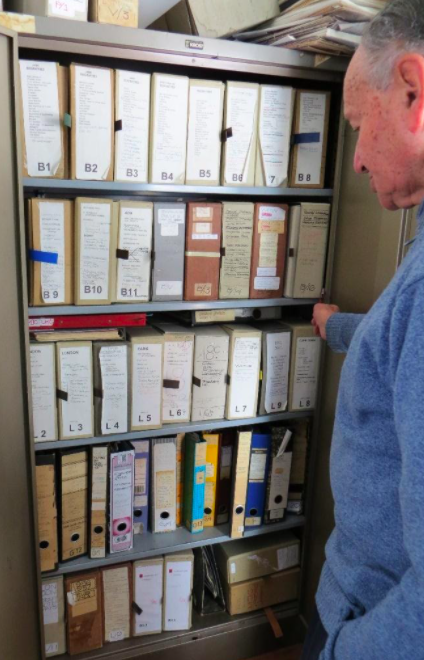 Clive Chipkin and his archive before removal to Wits