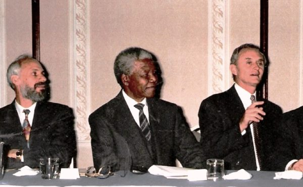SAJBD President Gerald Leissner and Chairman Mervyn Smith (pictured here with ANC President Nelson Mandela, SAJBD National Congress, 1993) were instrumental in the Board's taking a decisive stance against apartheid during the 1980s.