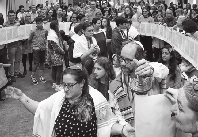 Simchat Torah celebration in Cape Town, led by Rabbis Emma Gottlieb and Malcolm Matitiani